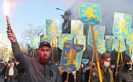 """In the photo: participants of the march of nationalists in honor of the day of the organization of the SS """"Galicia"""" division"""