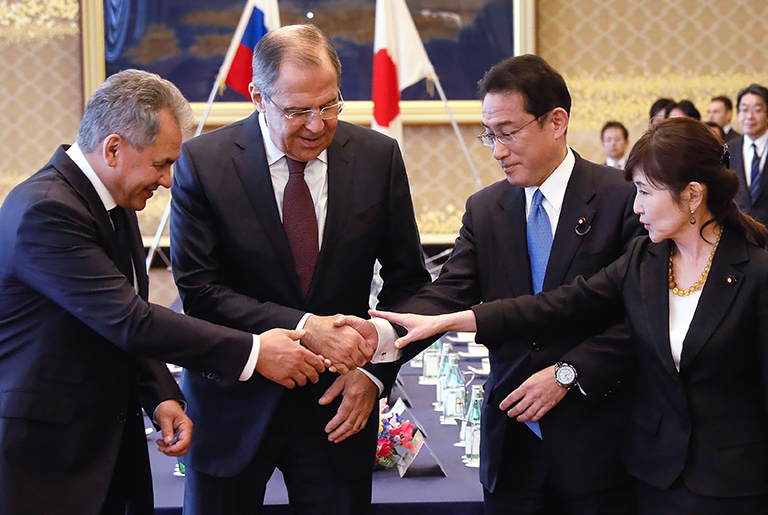 """In the photo: Russian Defense Minister Sergei Shoigu, Russian Foreign Minister Sergey Lavrov, Japanese Foreign Minister Fumio Kishida and Japanese Defense Minister Tomomi Inada (left to right) before the start of talks between the Russian and Japanese foreign ministers and defense ministers in the """"two plus two"""" format """", 2017."""
