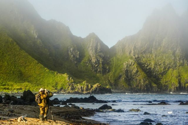 A Russian scientist stands on the shore of Cape Vasin of Urup Island in the southern group of the Great Ridge of the Kuril Islands.